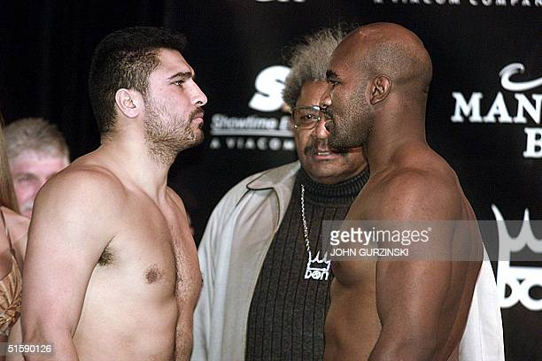 World Heavyweight Champion Evander Holyfield faces challenger John Ruiz during their weigh in 01 March at the Mandalay Bay Resort in Las Vegas Nevada...