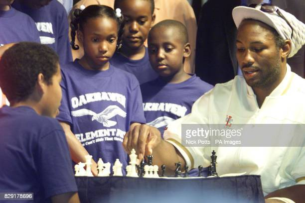 World Heavyweight Champion Lennox Lewis plays chess with local school boy Carlos Harbert aged 13 at Sam's Town Casino in Tunica prior to his fight...