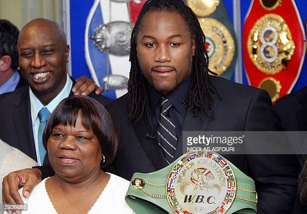 World Heavyweight champion Lennox Lewis poses with his WBC belt and his mom Violet Britain's top boxer announce his retirement from boxing at a press...