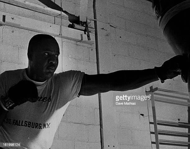 MAY 15 1963 MAY 23 1963 World heavyweight champion Sonny Liston bangs a solid left jab into the heavy punching bag during his daily workout at Lowry...