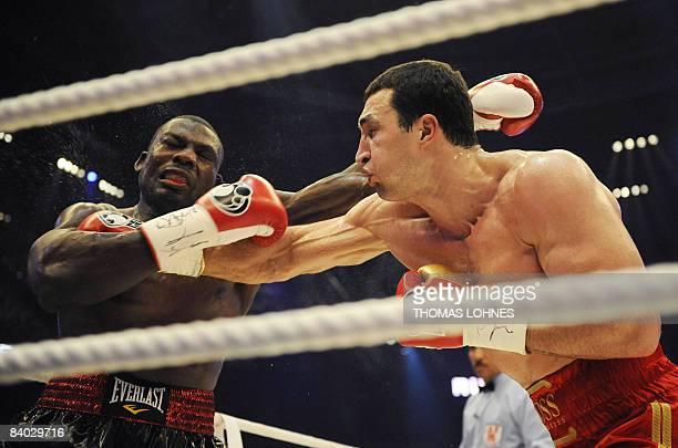World heavyweight champion Vladimir Klitschko fights against US challenger Hasim Rahman during the IBF and WBO heavyweight World Championship bout in...