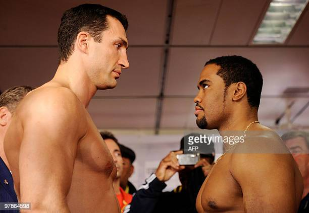 World heavyweight champion Vladimir Klitschko of the Ukraine and USA's Eddie Chambers face each other during the official weighing on March 19 2010...