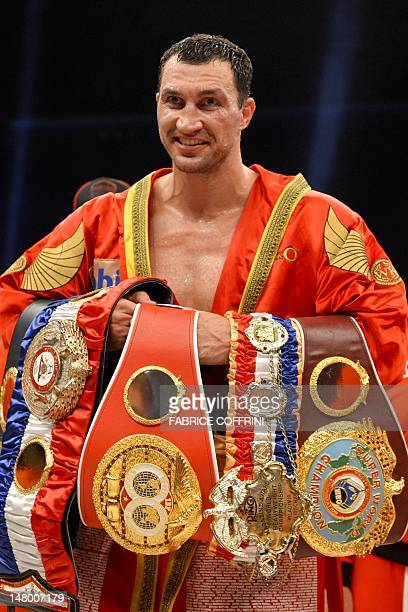 World heavyweight champion Wladimir Klitschko poses with his belts after his boxing fight against challenger Tony Thompson of the United States on...