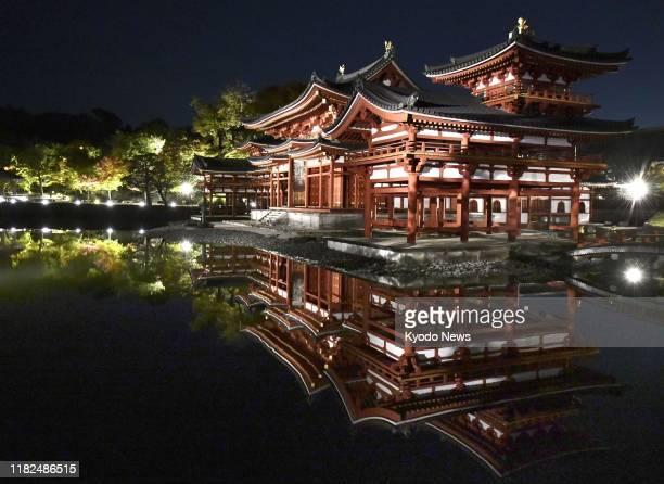 World Heritage site Byodoin Temple is lit up in Uji Kyoto western Japan on Nov 15 2019