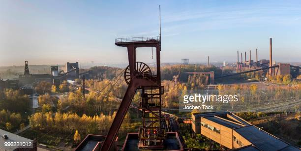unesco world heritage site, zeche zollverein, view on headframe shaft 1, on the left double shaft 12, right the coking plant, essen, north rhine-westphalia, germany - essen germany stock pictures, royalty-free photos & images