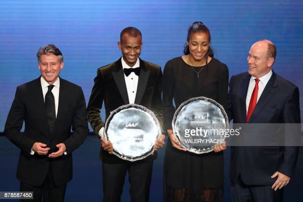 World high jump champion Qatar's Mutaz Essa Barshim and Belgium's athlete Nafissatou Thiam poses with their trophy with IAAF President Sebastian Coe...