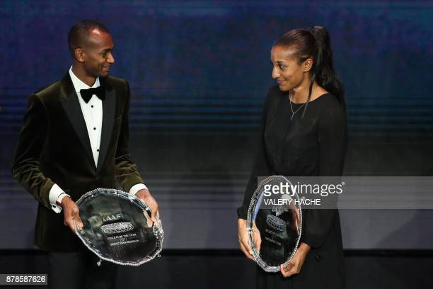 World high jump champion Qatar's Mutaz Essa Barshim and Belgium's athlete Nafissatou Thiam react with their trophy after being awarded Male and...