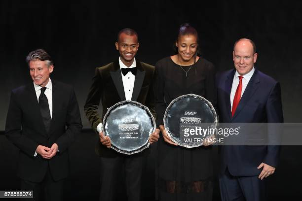 TOPSHOT World high jump champion Qatar's Mutaz Essa Barshim and Belgium's athlete Nafissatou Thiam poses with their trophy with IAAF President...