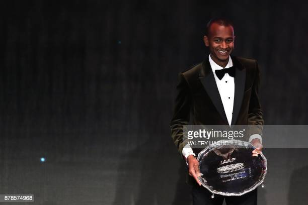 World high jump champion Qatar's Mutaz Essa Barshim poses with the trophy after being awarded Male Athlete of the Year 2017 during the International...