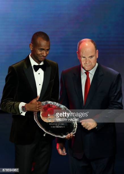 World high jump champion Qatar's Mutaz Essa Barshim poses with the trophy next to Prince Albert II of Monaco after being awarded Male Athlete of the...