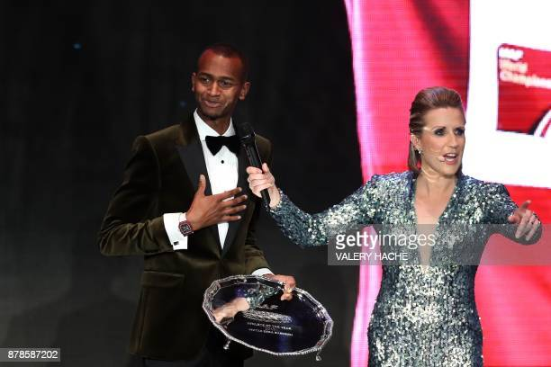 World high jump champion Qatar's Mutaz Essa Barshim reacts after being awarded Male Athlete of the Year 2017 during the International Association of...