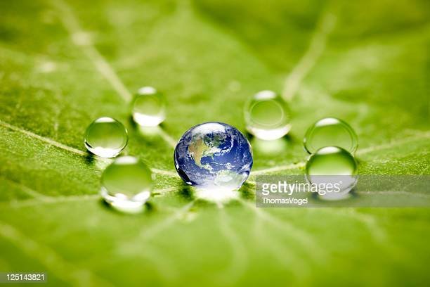 world in a drop macro - world kindness day stock photos and pictures