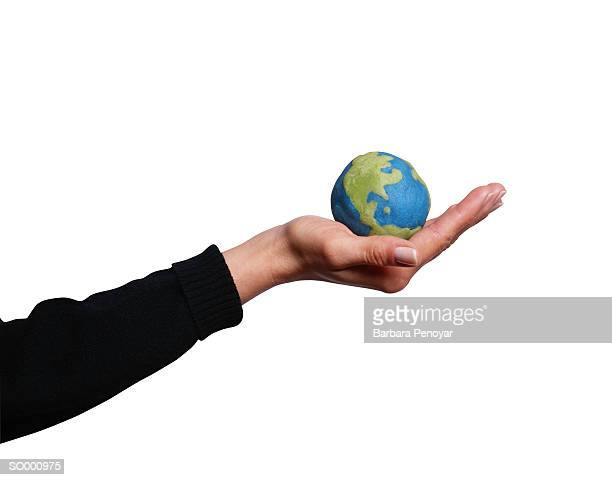 world in her hands - world at your fingertips stock pictures, royalty-free photos & images