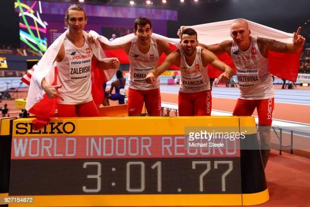 World Indoor Record Holders Karol Zalewski Rafal Omelko Lukasz Krawczuk and Jakub Krzewina of Poland celebrate winning the Men's 4 x 400 Metres Relay...