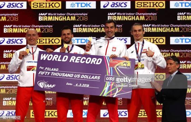World Indoor Record holders Karol Zalewski Rafal Omelko Lukasz Krawczuk and Jakub Krzewina of Poland after winning the Men's 4 x 400 Metres Relay...