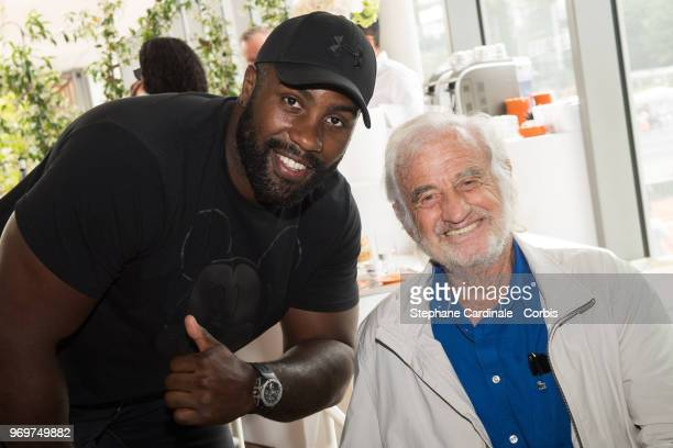 World Judo Champion Teddy Riner and actor Jean Paul Belmondo attend the 2018 French Open - Day Thirteen at Roland Garros on June 8, 2018 in Paris,...