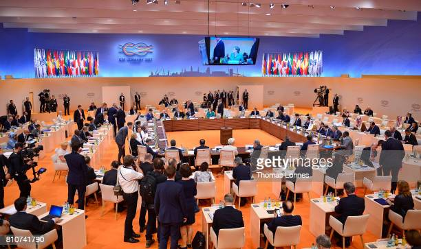 World leaders and delegates arrive to attend the morning working session on the second day of the G20 economic summit on July 8 2017 in Hamburg...