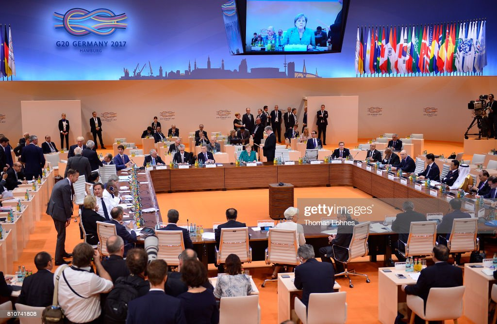 World leaders and delegates arrive to attend the morning working session on the second day of the G20 economic summit on July 8, 2017 in Hamburg, Germany. G20 leaders have reportedly agreed on trade policy for their summit statement but disagree over climate change policy.