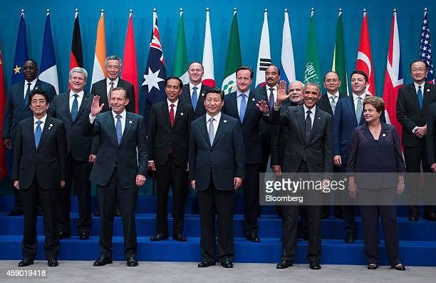 World leaders and delegates pose for a family photograph at the Group of 20 summit in Brisbane, Australia, on Saturday, Nov. 15, 2014. Front row,...
