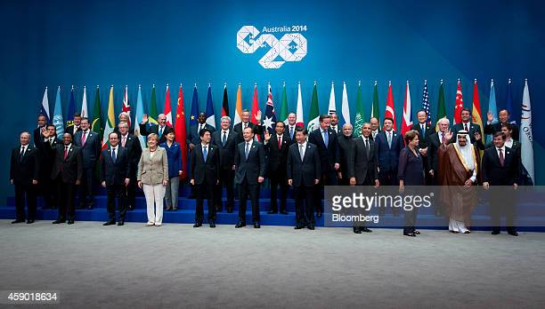 World leaders and delegates react after posing for a family photograph at the Group of 20 summit in Brisbane, Australia, on Saturday, Nov. 15, 2014....