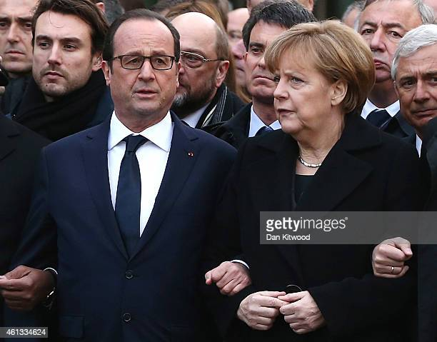 World leaders and dignitaries including French President Francois Hollande French Prime Minister Manuel Valls and German Chancellor Angela Merkel...