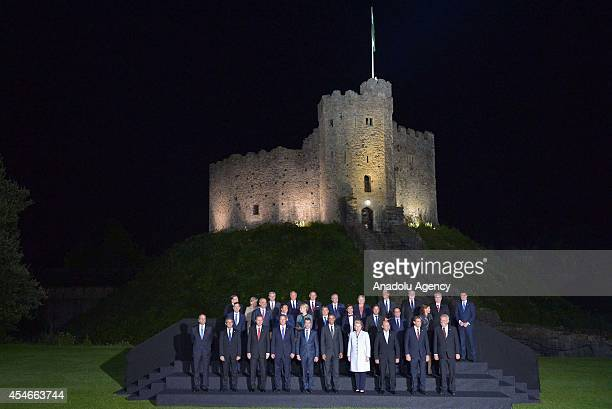 World leaders and senior ministers pose for a family photo at the NATO Summit in front of Cardiff Castle on September 4 2014 in Cardiff Wales Leaders...