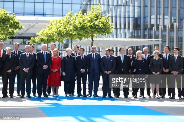 World leaders gather for a family photograph during a summit at the North Atlantic Treaty Organization headquarters in Brussels Belgium on Thursday...