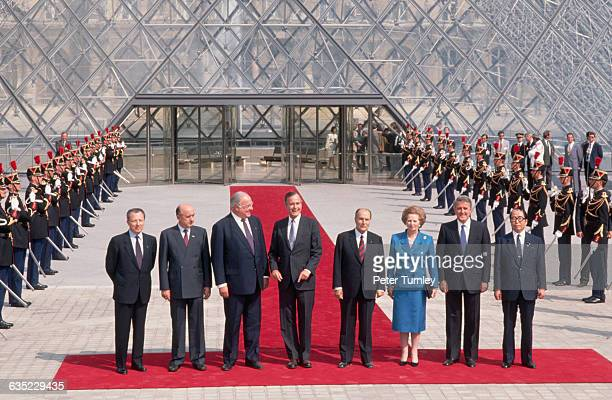 World leaders gathered in Paris for the G7 economic summit pose in front of the Pyramid at the Louvre. From left: Jacques Delors, President of the...