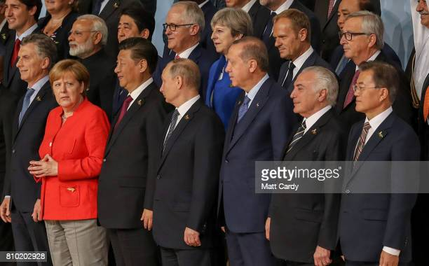 World leaders pose for a family photo during the G20 summit on July 7 2017 in Hamburg Germany Leaders of the G20 group of nations are meeting for the...