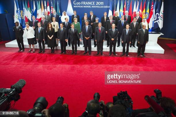World leaders pose for a family photo on November 3 2011 during the G20 Summit of Heads of State and Government in Cannes The leaders of the world's...