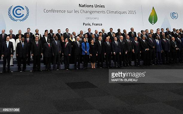 World leaders pose for a family picture during the COP21, United Nations Climate Change Conference, in Le Bourget, outside Paris, on November 30,...