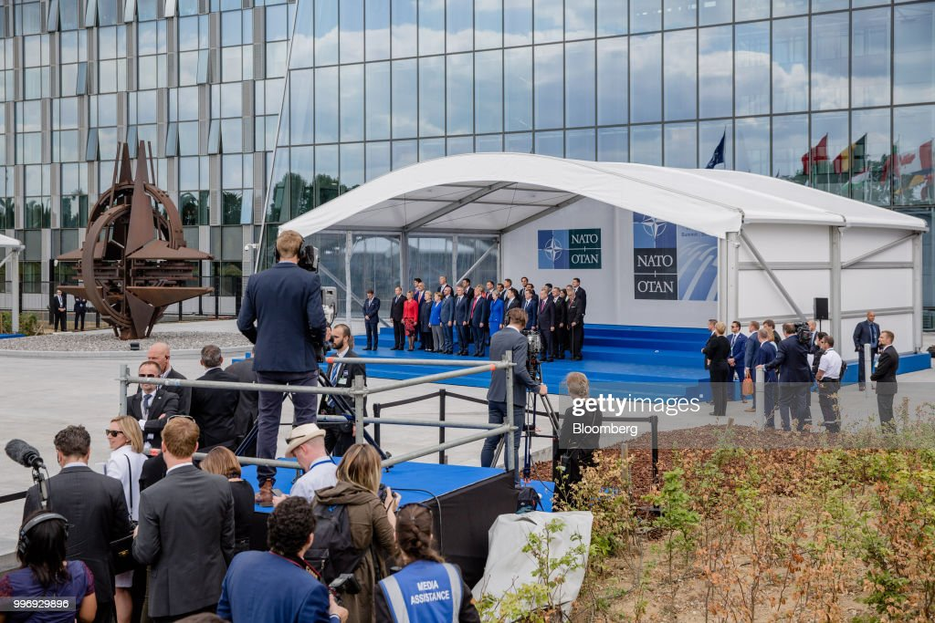 World leaders stand on a platform for a family photograph during the North Atlantic Treaty Organization (NATO) summit at the military and political alliance's headquarters in Brussels, Belgium, on Wednesday, July 11, 2018. President Donald Trump opened up another front in his tussle with allies on his arrival at NATOs annual summit, targeting Germany over its support for the Nord Stream 2 gas pipeline from Russia. Photographer: Marlene Awaad/Bloomberg via Getty Images