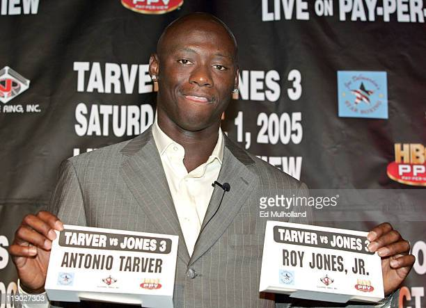 World Light Heavyweight Champion Antonio Tarver poses with Roy Jones Jr's name card during the press conference announcing their rubber match The...