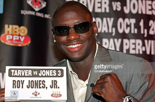 World Light Heavyweight Champion Antonio Tarver poses with Roy Jones Jr.'s name card during the press conference announcing their rubber match. The...
