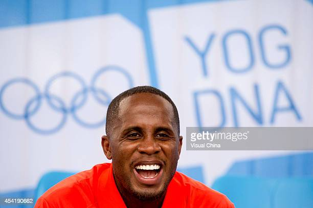 World Long Jump champion Dwight Phillips of United States attends the IAAF Kids Athletics Program at Yanshan Road on August 26 2014 in Nanjing China
