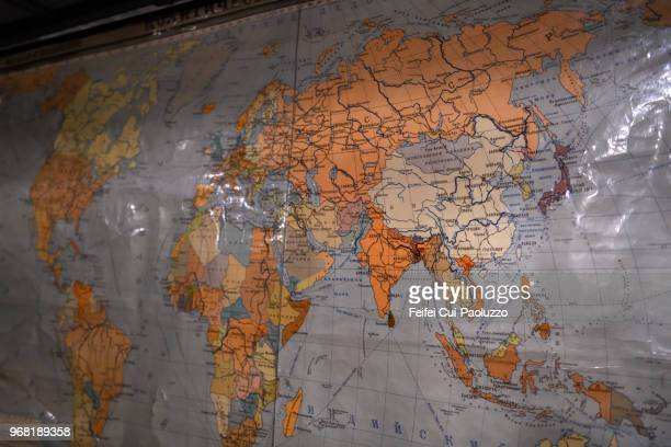 world map at plokštinė missile base, lithuania. - country geographic area stock pictures, royalty-free photos & images