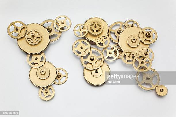 world map formed by gears - gear stock pictures, royalty-free photos & images