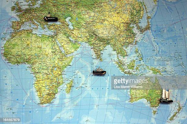 A world map indicating Greenpeace ship locations hangs on the wall of the Rainbow Warrior whilst docked at the Overseas Passenger Terminal in...