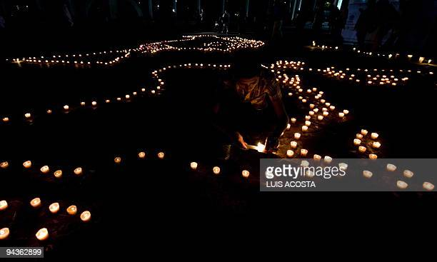 A world map made with candles by members of Greenpeace is seen during a demonstration against Climate Change in Mexico City on December 12 2009 In...