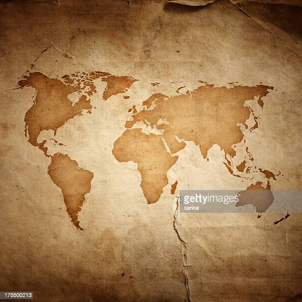 world map on aged paper texture background - vintage world map stock photos and pictures