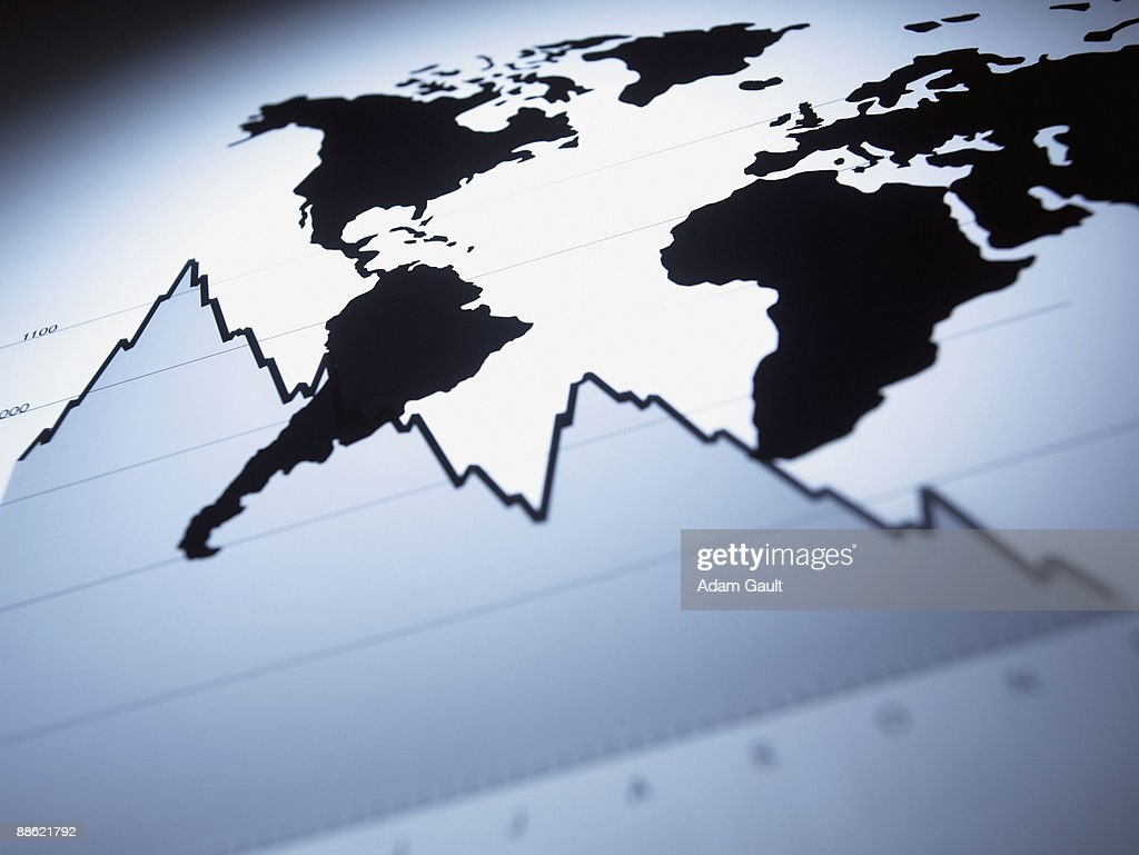 World map on descending line graph : Stock Photo