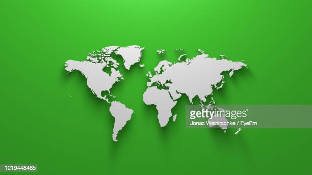 world map on green background - world map stock pictures, royalty-free photos & images