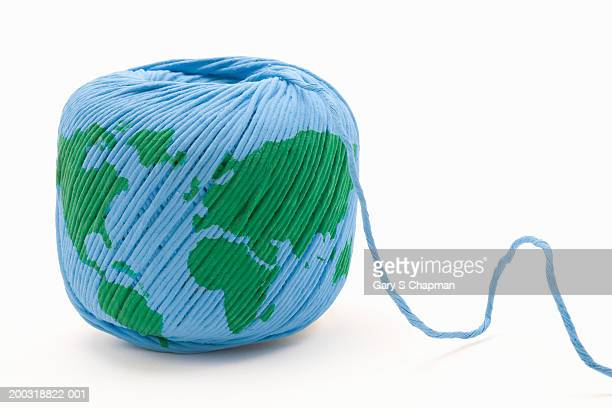 World map painted on unraveling ball of string