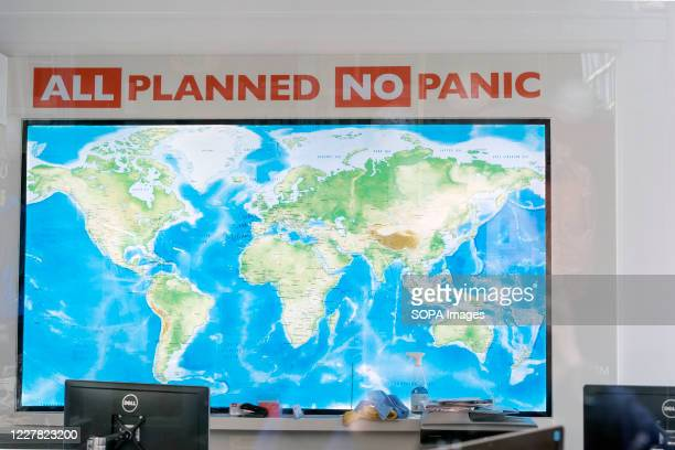 """World map seen with words reading """"All Planned No Panic"""" in the Flight Centre store in Covent Garden, London. All Flight Centre stores remain closed..."""