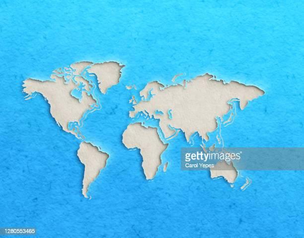 world map with paper cut effect on blue background - europa continente fotografías e imágenes de stock