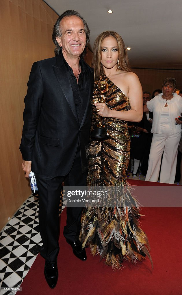 World Music Awards Producer John Martinotti (L) and singer Jennifer Lopez pose backstage during the World Music Awards 2010 at the Sporting Club on May 18, 2010 in Monte Carlo, Monaco.