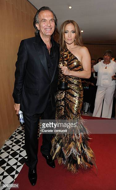 World Music Awards Producer John Martinotti and singer Jennifer Lopez pose backstage during the World Music Awards 2010 at the Sporting Club on May...