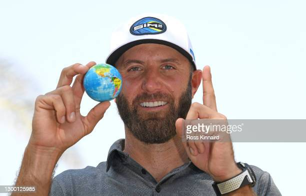 World number 1 Dustin Johnson of the USA poses with a globe during the pro-am event prior to the Saudi International powered by SoftBank Investment...