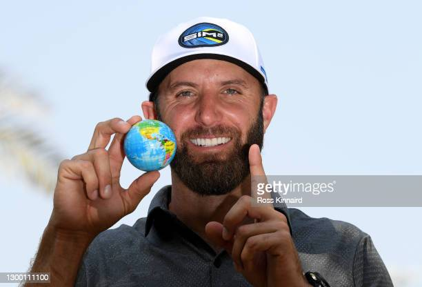 World number Dustin Johnson of the USA poses with a globe during the pro-am event prior to the Saudi International powered by SoftBank Investment...