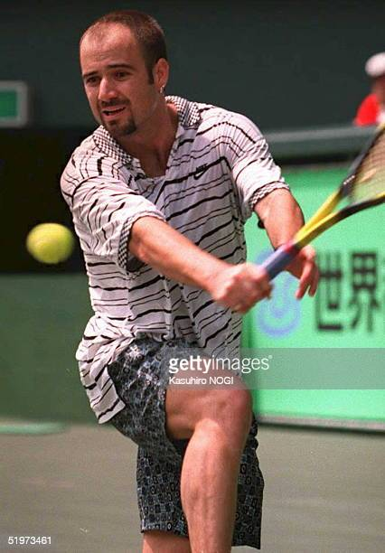 World number one Andre Agassi of the US gets ready to return the ball against Wayne Ferreira of South Africa during their semifinal match of the...